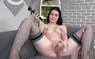Teen in slutty fishnets working with a dildo