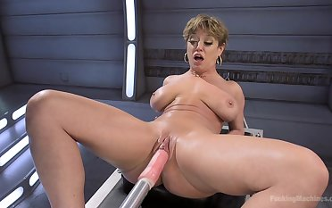 Short hair Dee Williams penetrated in both holes with a fuck tackle