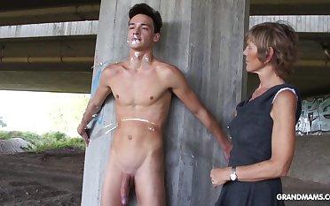 Nympho granny sucks a big horseshit of tied up naked guy