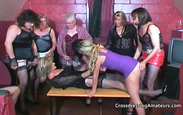 Older crossdressers with two attractive  females