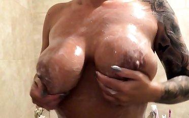 Mya Luanna jerk off the brush partner inside the shower enclosure