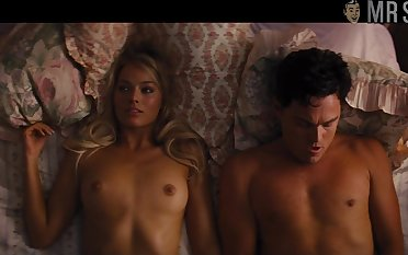 Pulchritudinous and dispirited Margot Robbie flashes tits while doing some kind of bed scenes