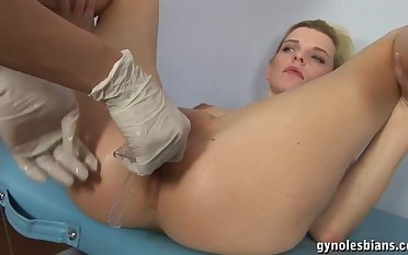 Lesbian getting fucked with a fake cock