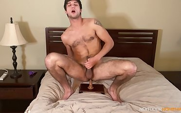 Gay lad works his toy in solo anal scenes on the top of cam