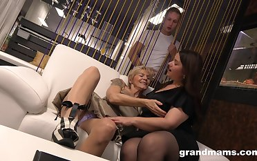 A curious young man catches two mature BBWs playing with each other