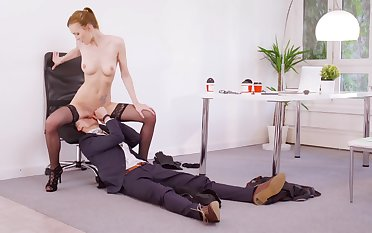Vitalized redhead rides boss's dick for a bigger raise