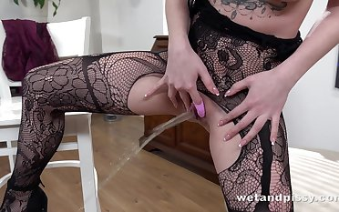 Inviting dark haired Kira Axe wears sexy lingerie increased by masturbates her messy pussy