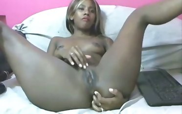 This dark skinned Colombian stunner is fingering say no to lady holes on cam