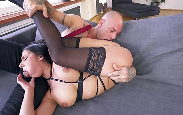 Man's huge dong slides into her ass the hard showing