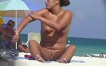 Stripped breasty honey widens legs readily obtainable the beach